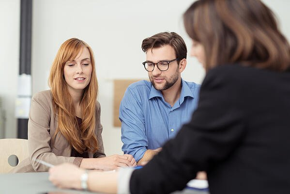 Performance evaluation meeting between coworkers and manager