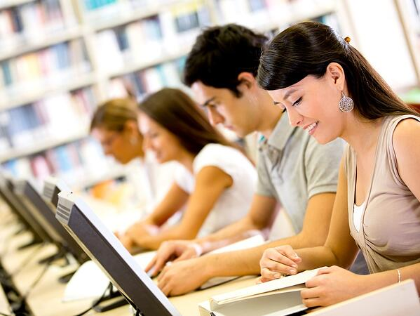 Employees working throughout online training courses.