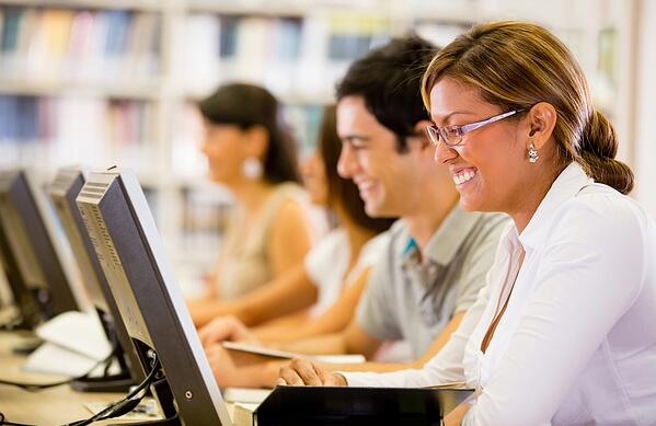 Employees taking their online learning courses with a learning management system