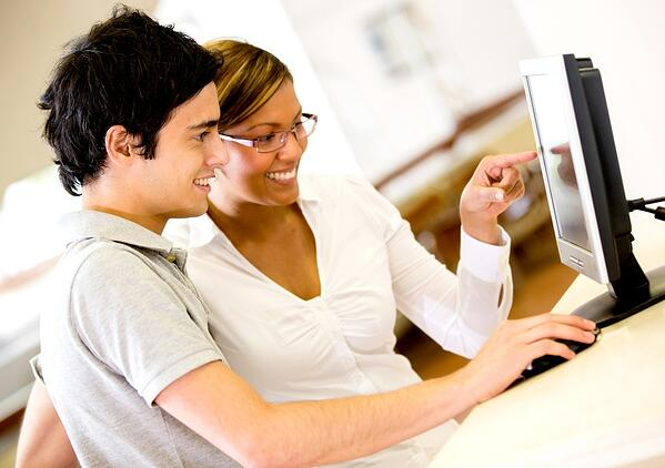 Online e-learning course being completed between two people.
